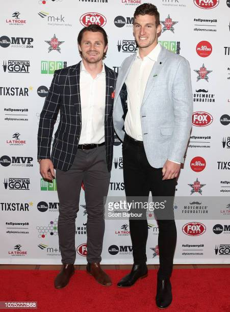 Patrick Dangerfield of the Cats and Josh Jenkins of the Crows pose during the 2018 AFL Players' MVP Awards at the Basement on August 30 2018 in...