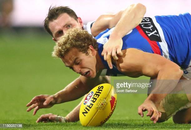 Patrick Dangerfield of the Cats and Mitch Wallis of the Bulldogs compete for the ball during the round nine AFL match between the Geelong Cats and...