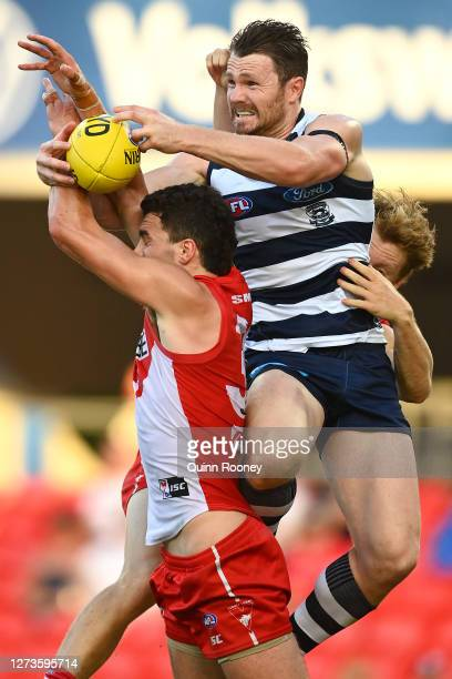 Patrick Dangerfield of the Cats attempts to mark over Tom McCartin of the Swans during the round 18 AFL match between the Sydney Swans and the...