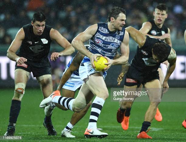 Patrick Dangerfield of the Cats breaks free of the centre during the round 23 AFL match between the Geelong Cats and the Carlton Blues at GMHBA...