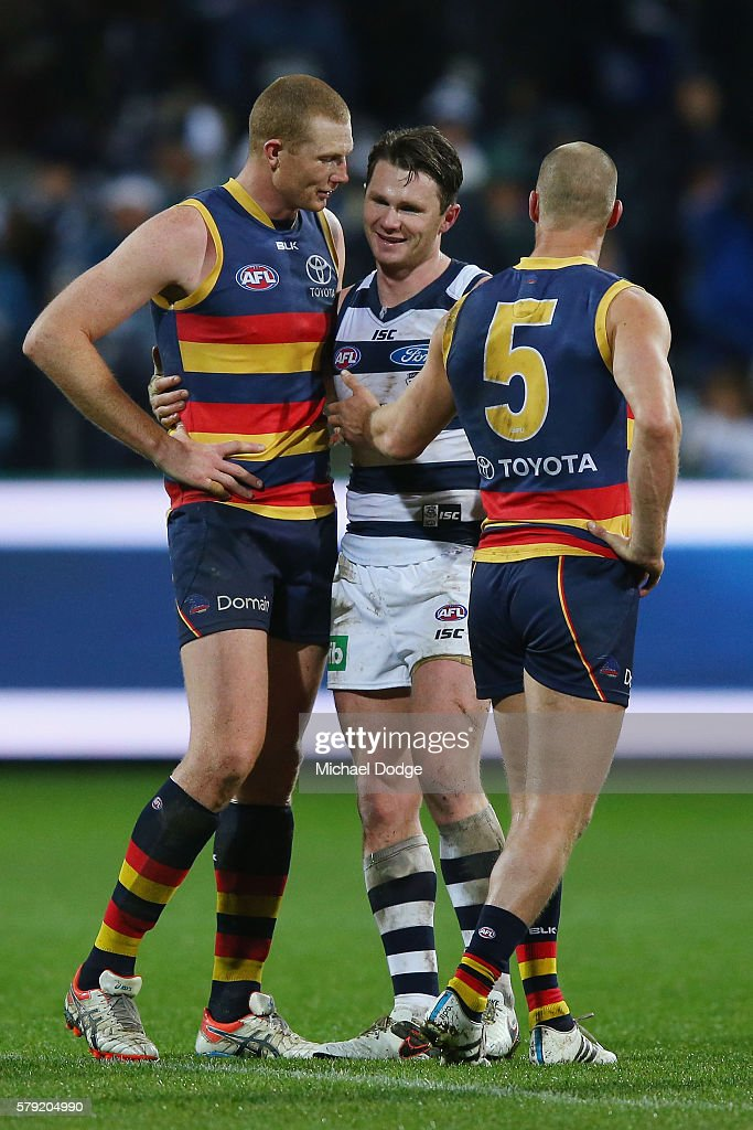 Patrick Dangerfield (R) of the Cats catches up with Sam Jacobs of the Crows (L) and Scott Thompson after his win during the round 18 AFL match between the Geelong Cats and the Adelaide Crows at Simonds Stadium on July 23, 2016 in Geelong, Australia.