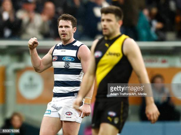 Patrick Dangerfield of the Cats celebrates on the final siren as Trent Cotchin of the Tigers looks dejected during the 2017 AFL round 21 match...