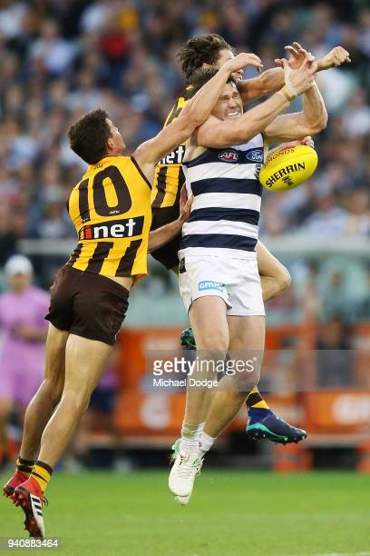 Patrick Dangerfield of the Cats compete for the ball against Jaeger O'Meara of the Hawks and Isaac Smith of the Hawks during the round two AFL match...
