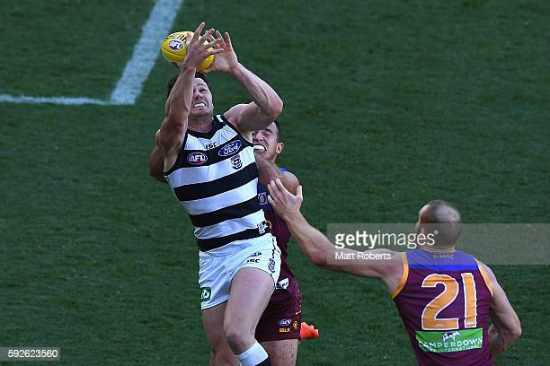 Patrick Dangerfield of the Cats competes for the ball during the round 22 AFL match between the Brisbane Lions and the Geelong Cats at The Gabba on...