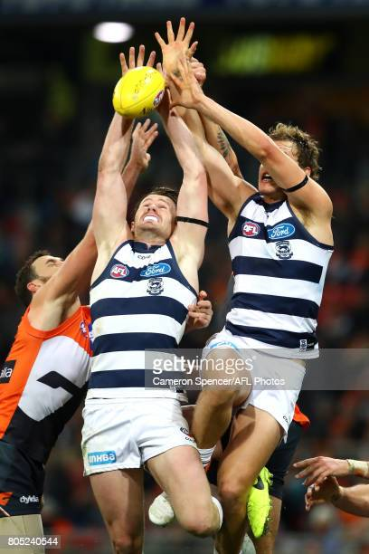Patrick Dangerfield of the Cats contests the ball during the round 15 AFL match between the Greater Western Sydney Giants and the Geelong Cats at...