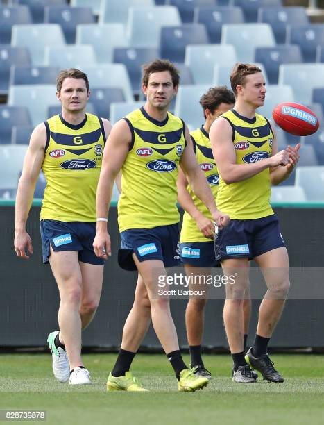 Patrick Dangerfield of the Cats Daniel Menzel of the Cats and Mitch Duncan of the Cats look on during a Geelong Cats AFL training session at Simonds...