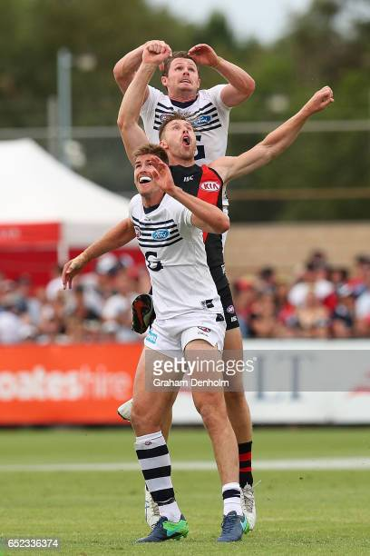 Patrick Dangerfield of the Cats gets above his opponent during the JLT Community Series AFL match between the Geelong Cats and the Essendon Bombers...