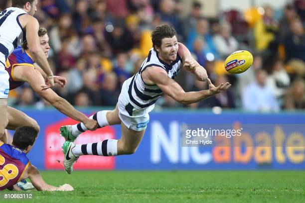 Patrick Dangerfield of the Cats handballs during the round 16 AFL match between the Brisbane Lions and the Geelong Cats at The Gabba on July 8, 2017...