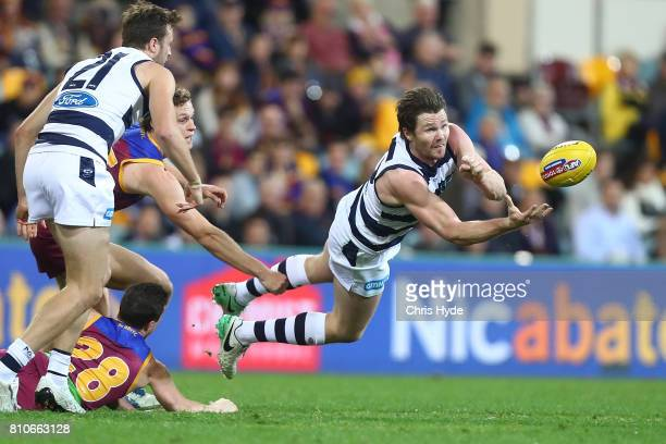 Patrick Dangerfield of the Cats handballs during the round 16 AFL match between the Brisbane Lions and the Geelong Cats at The Gabba on July 8 2017...