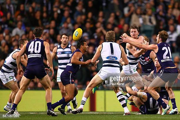 Patrick Dangerfield of the Cats handballs during the round 17 AFL match between the Fremantle Dockers and the Geelong Cats at Domain Stadium on July...