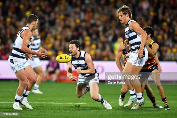 Patrick Dangerfield of the Cats handballs during the round 18 AFL match between the Adelaide Crows and the Geelong Cats at Adelaide Oval on July 21,...