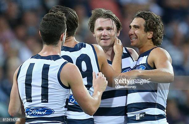 Patrick Dangerfield of the Cats is congratulated by team mates after kicking a goal during the 2016 NAB Challenge match between the Geelong Cats and...