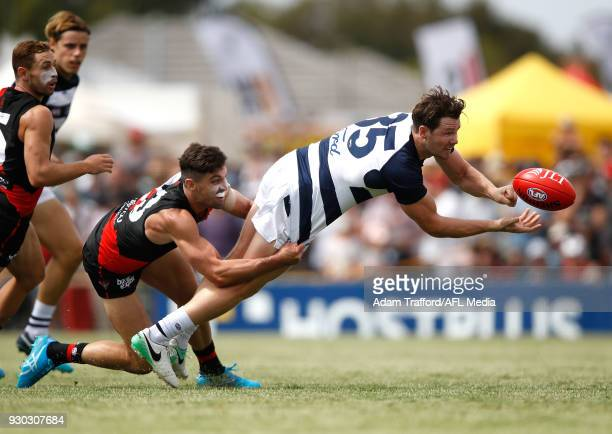 Patrick Dangerfield of the Cats is tackled by David Myers of the Bombers during the AFL 2018 JLT Community Series match between the Geelong Cats and...