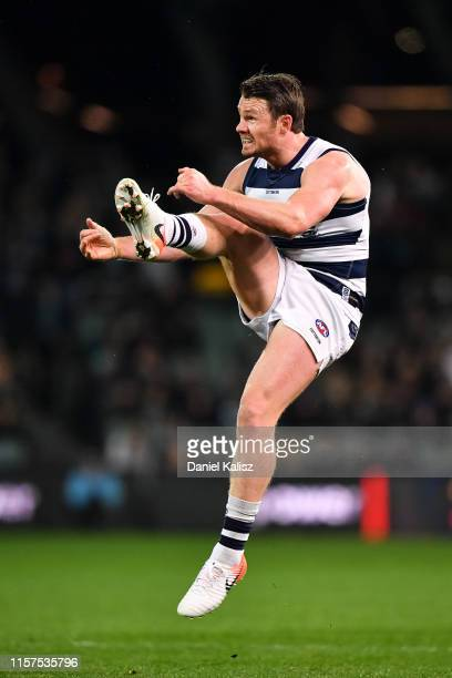 Patrick Dangerfield of the Cats kicks the ball during the round 14 AFL match between the Port Adelaide Power and the Geelong Cats at Adelaide Oval on...