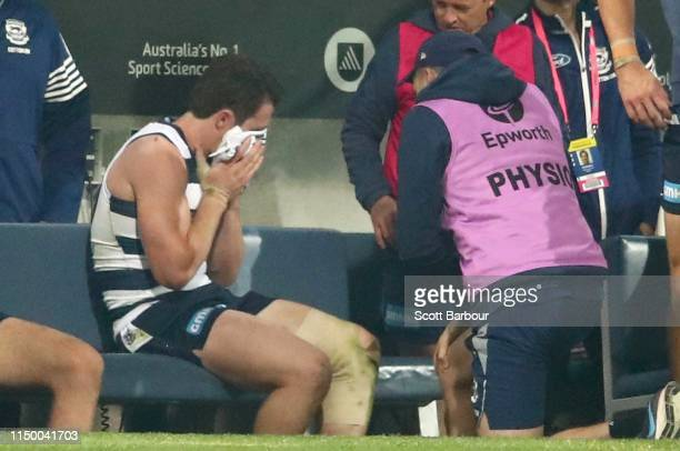 Patrick Dangerfield of the Cats leaves the field injured during the round nine AFL match between the Geelong Cats and the Western Bulldogs at GMHBA...