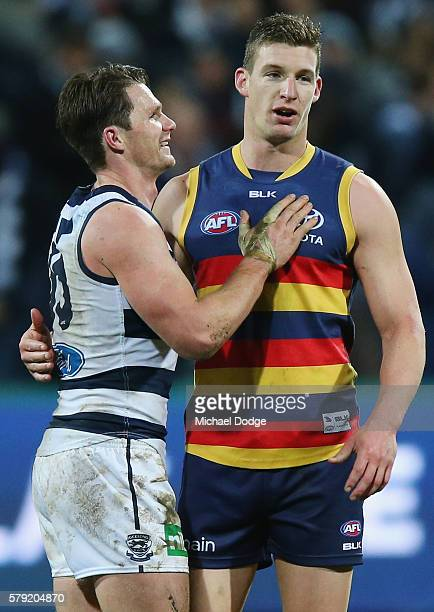Patrick Dangerfield of the Cats pats good matJosh Jenkins of the Crows after his win during the round 18 AFL match between the Geelong Cats and the...