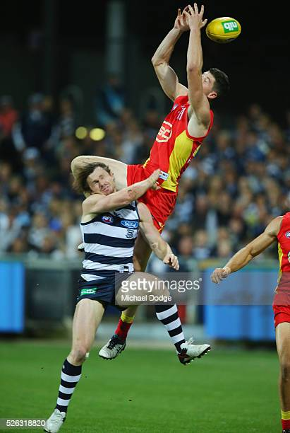 Patrick Dangerfield of the Cats reacts after being hit in the head from a contest with Henry Schade of the Suns during the round six AFL match...