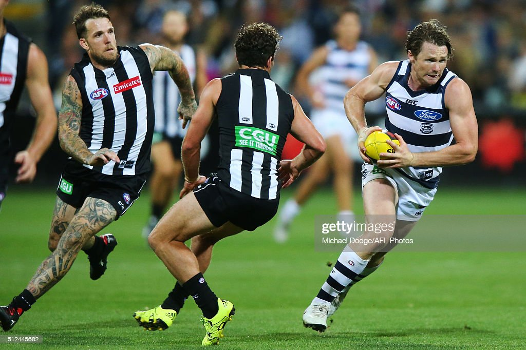 Patrick Dangerfield of the Cats runs with the ball away Dane Swan of the Magpies and Jarryd Blair (R) during the 2016 NAB Challenge match between the Geelong Cats and the Collingwood Magpies at Simonds Stadium on February 26, 2016 in Geelong, Australia.