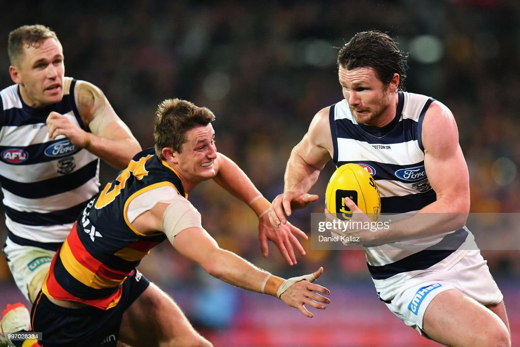 Patrick Dangerfield of the Cats runs with the ball during the round 17 AFL match between the Adelaide Crows and the Geelong Cats at Adelaide Oval on July 12, 2018 in Adelaide, Australia.