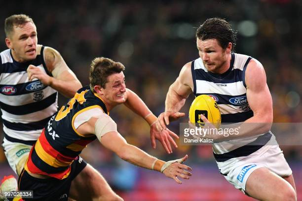 Patrick Dangerfield of the Cats runs with the ball during the round 17 AFL match between the Adelaide Crows and the Geelong Cats at Adelaide Oval on...