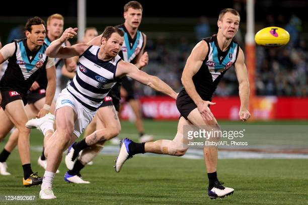 Patrick Dangerfield of the Cats tackles Robbie Gray of the Power during the 2021 AFL Round 23 match between the Adelaide Crows and the North...