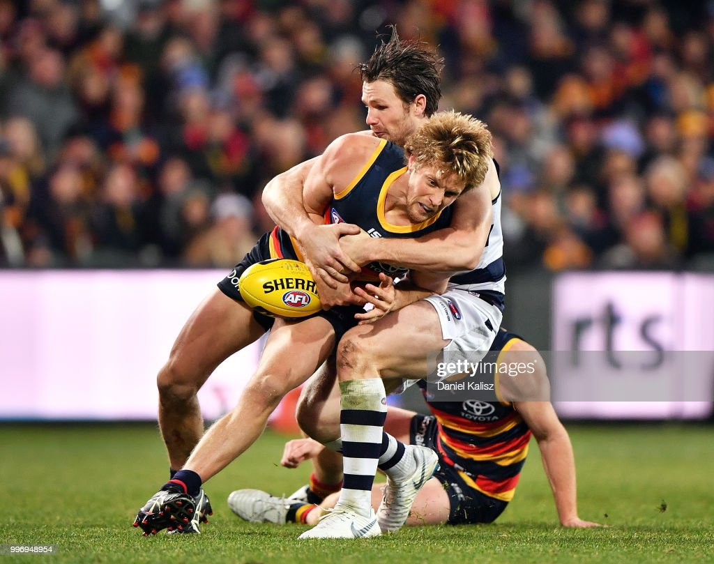 Patrick Dangerfield of the Cats tackles Rory Sloane of the Crows during the round 17 AFL match between the Adelaide Crows and the Geelong Cats at Adelaide Oval on July 12, 2018 in Adelaide, Australia.