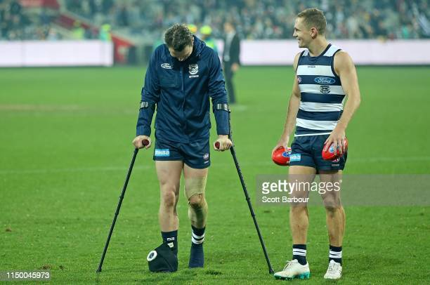 Patrick Dangerfield of the Cats talks to Joel Selwood of the Cats as he leaves the field injured after the round nine AFL match between the Geelong...