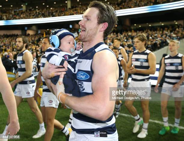 Patrick Dangerfield of the Cats walk out with baby George or his 200th match during the AFL Second Qualifying Final Match between the Geelong Cats...