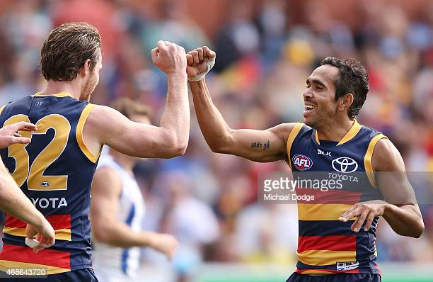 Patrick Dangerfield of the Crows and Eddie Betts of the Crows celebrate a goal during the round one AFL match between the Adelaide Crows and the...
