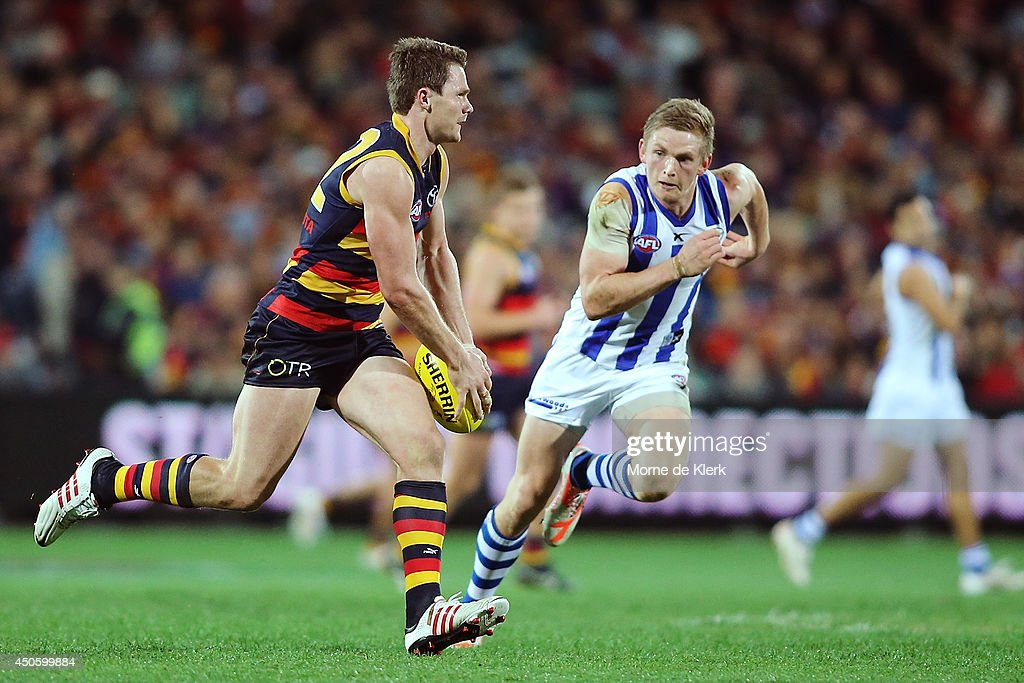 Patrick Dangerfield of the Crows gets away from Jack Ziebell of the Kangaroos during the round 13 AFL match between the Adelaide Crows and the North Melbourne Kangaroos at Adelaide Oval on June 14, 2014 in Adelaide, Australia.