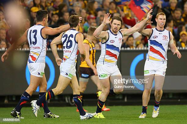 Patrick Dangerfield of the Crows is congratulated by team mates after kicking a goal during the Second AFL Semi Final match between the Hawthorn...