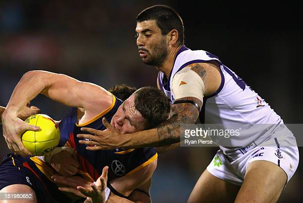Patrick Dangerfield of the Crows is tackled by Clancee Pearce of the Dockers during the AFL Second Semi Final match between the Adelaide Crows and...