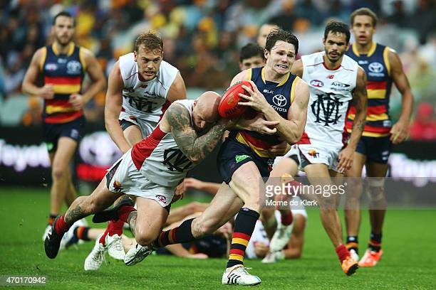 Patrick Dangerfield of the Crows is tackled by Nathan Jones of the Demons during the round three AFL match between the Adelaide Crows and the North...