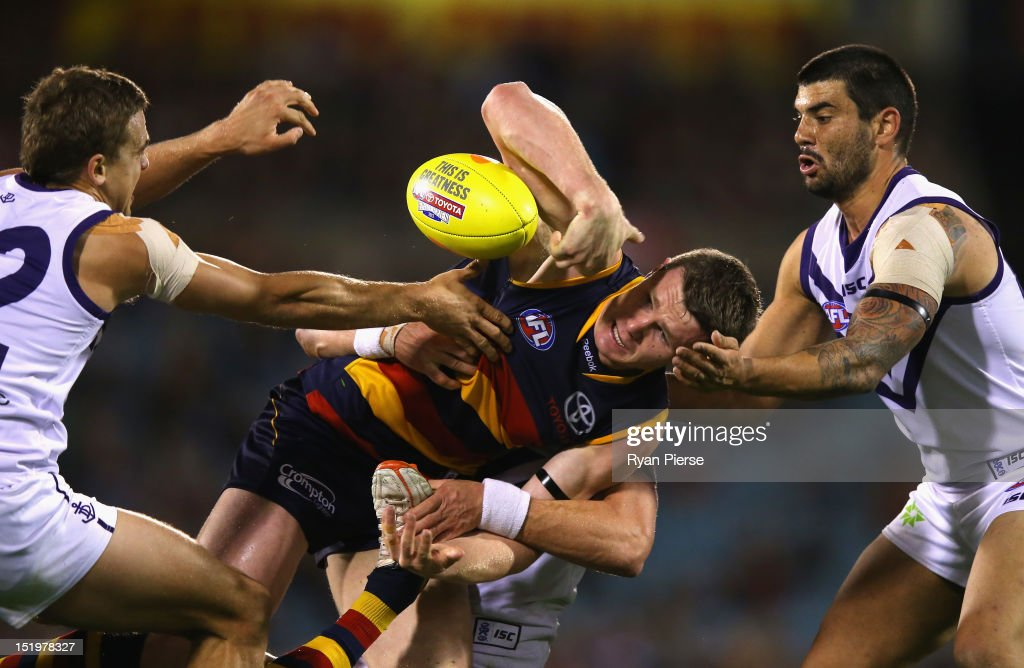 Patrick Dangerfield of the Crows is tackled during the AFL Second Semi Final match between the Adelaide Crows and the Fremantle Dockers at AAMI Stadium on September 14, 2012 in Adelaide, Australia.