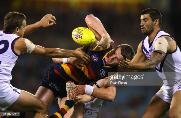 Patrick Dangerfield of the Crows is tackled during the AFL Second Semi Final match between the Adelaide Crows and the Fremantle Dockers at AAMI...