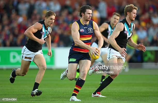 Patrick Dangerfield of the Crows looks to pass the ball during the round five AFL match between the Adelaide Crows and the Port Adelaide Power at...