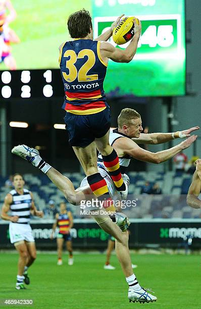 Patrick Dangerfield of the Crows marks the ball over Sam Blease of the Cats during the NAB Challenge AFL match between the Geelong Cats and the...