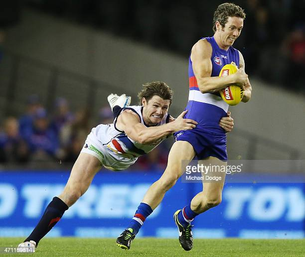 Patrick Dangerfield of the Crows tackles Robert Murphy of the Bulldogs during the round four AFL match between the Western Bulldogs and the Adelaide...