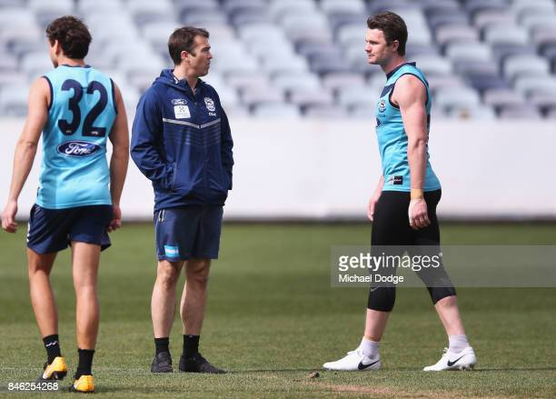 Patrick Dangerfield talks with Cats head coach Chris Scott during the Geelong Cats AFL training session at Simonds Stadium on September 13 2017 in...