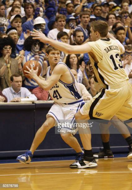 Patrick Davidson of the Duke Blue Devils looks to move the ball against Vytas Danelius of the Wake Forest Demon Deacons during the game at Cameron...