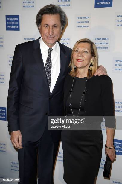 Patrick de Carolis and CarolAnne Hartpence attend La Recherche en Physiologie Charity Gala at Four Seasons Hotel George V on March 13 2017 in Paris...