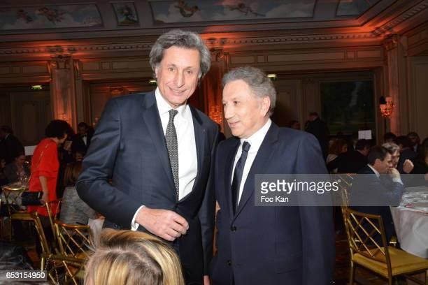 Patrick de Carolis and Michel Drucker attend 'La Recherche en Physiologie' Charity Gala at Four Seasons Hotel George V on March 13 2017 in Paris...