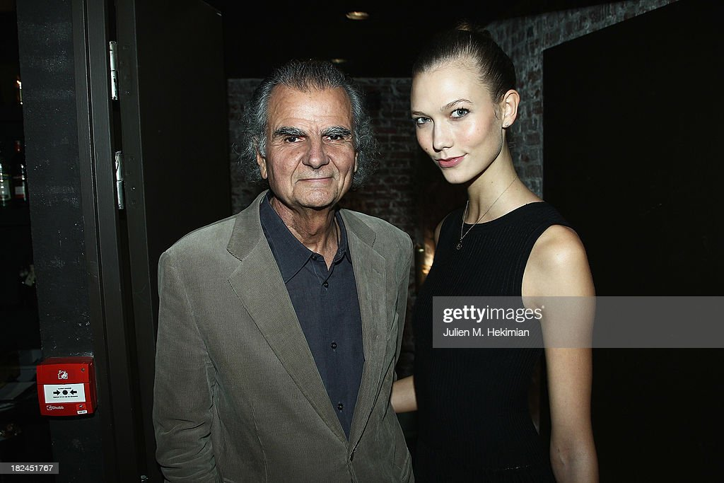 Patrick Demarchelier and Karlie Kloss attend the Glamour dinner for Patrick Demarchelier as part of the Paris Fashion Week Womenswear Spring/Summer 2014 at Monsieur Bleu restaurant on September 29, 2013 in Paris, France.