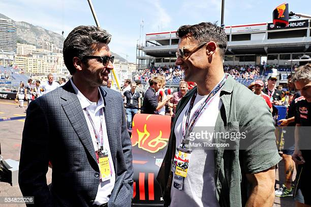 Patrick Dempsey actor talks with Dan Carter rugby player outside the Red Bull Racing garage ahead of qualifying for the Monaco Formula One Grand Prix...