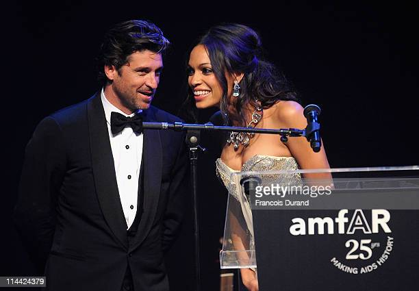 Patrick Dempsey and Rosario Dawson onstage at amfAR's Cinema Against AIDS Gala during the 64th Annual Cannes Film Festival at Hotel Du Cap on May 19,...