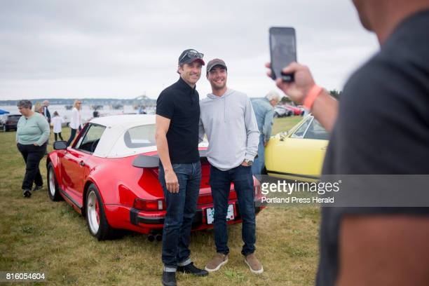 Patrick Dempsey at left poses for a photo with Alex Katz of Kennebunkport in front of Katz's 1988 Porsche 930 during a Porsche car show to benefit...