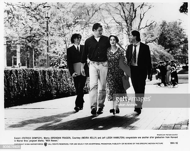 Patrick Dempsey Brendan Fraser Moira Kelly and Josh Hamilton walks on campus in a scene from the Warner Bros movie 'With Honors' circa 1994