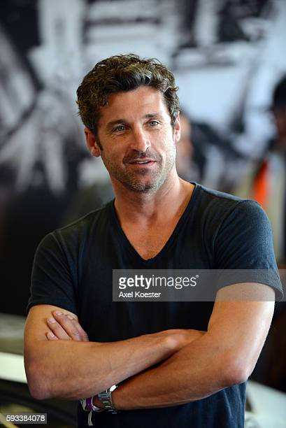 Patrick Dempsey hangs out with fellow Porsche fans at the Porsche paddock at the Rolex Monterey Motorsports Reunion held at the Laguna Seca Mazda...