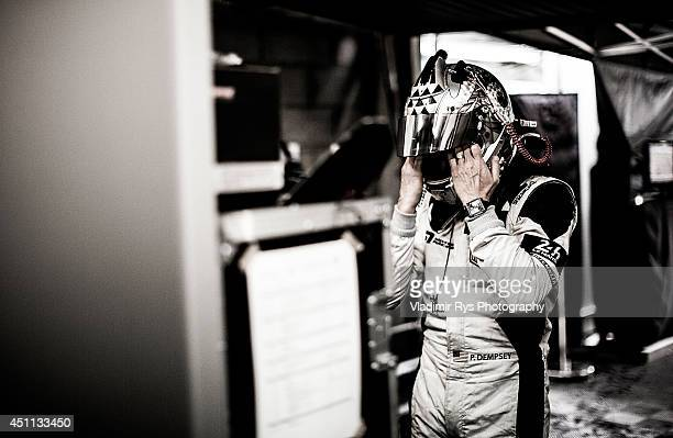 Patrick Dempsey of the USA and Dempsey Racing Proton prepares in the garage ahead of his first stint during the Le Mans 24 Hour Race at Circuit de la...