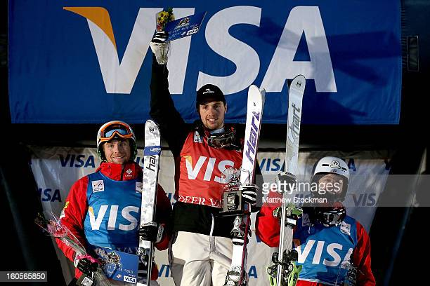 Patrick Deneen in second place Alex Bilodeau of Canada in first place and Bradley Wilson in third place pose for photographers on the winners podium...